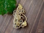 Gold coloured wire wrapped brooch with leaves by IanirasArtifacts
