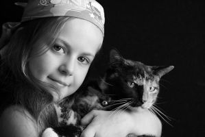 A girl and her cat by JudiLiosatos