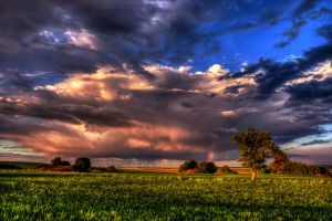 stormy sunset and rainbow by stg123