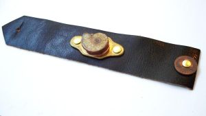 Leather and Ammonite Cuff by salvagedsword