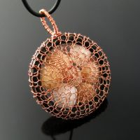 Wire knit pendant with caged shells by CatsWire