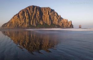 First Light on Morro Rock by twelvemotion