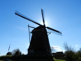 Windmill against the sun by andreibsc