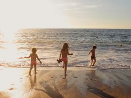 Our Kids Playing in Water Before Sunset by KMourzenko