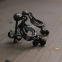 Black twist earrings by Jealousydesign