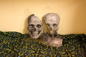 Skulls and crown on glass by AdomasWillKill