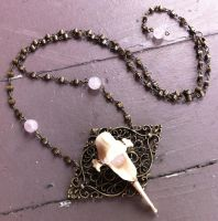 Bobcat Vertebra and Rose Quartz by bluereverie