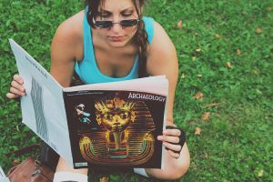 Lara is reading 'Archeology' magazine by OneMorePike