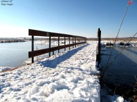 Bridge Over Frozen Water by GlimmerofHopeImages