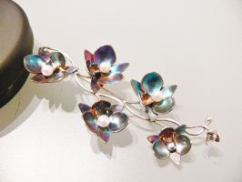 Blue patinated silver orchid brooch by irineja