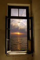 Sunset through the old window by papadimitriou
