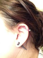 Industrial Piercing by ArtsyLibrarian