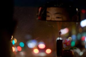Shanghai taxi driver by JohnTheByronicHero
