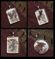 Wolf and Raptor Pendants by MorRokko