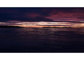 Sunset by the ice covered Sea by wchild