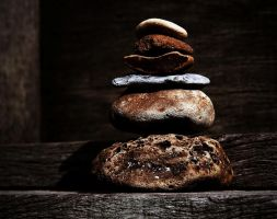 rock stack on wood by awjay