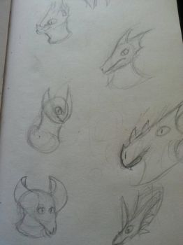 More dragon heads by Draconic-Artist