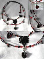 Red Queen Inspired Necklace by JozzyKane