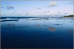 Clouds on wet sand by wildplaces