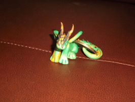 Green and gold dragon by spot1the2dog3