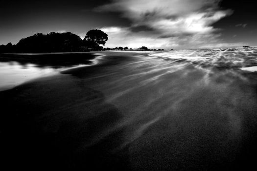 Waves of sand by light-recycled