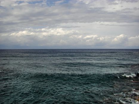 Stock Photo: blue ocean background with clouds by elisafox-stock