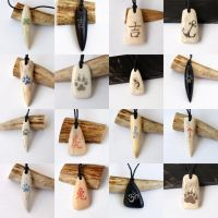 Engraved antler, corian and buffalo horn pendants by BDSart