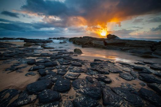 Sunrise on the Beach with some Rocks and Stuff by carlosthe