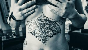 skull wings tattoo by foxxmax
