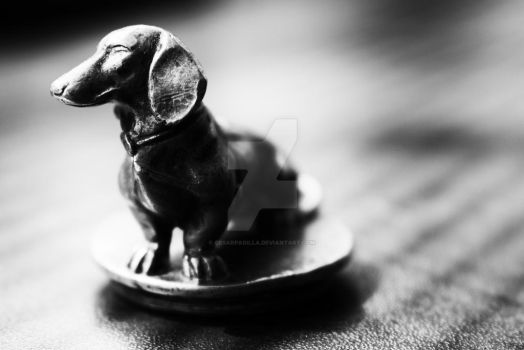 Brass dachshund in black and white. by cesarpadilla