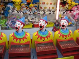 Clowns smiling in a row by girlpsychic