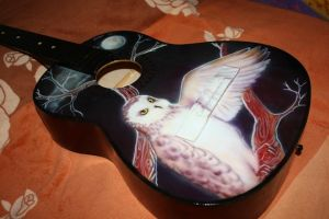 Owl on the guitar by WhiteOwly