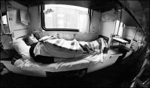 Russia. Old lady in train by iBrick