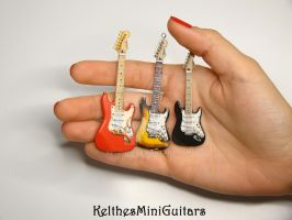 Three different guitar pendants by Kelthes