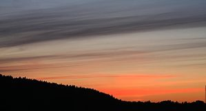 Striped sky over the mountain. by Sparvoga