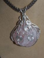 raw rose quartz wraped pendant by Jessicapilot901