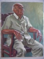 man sitting on a chair by Hemali