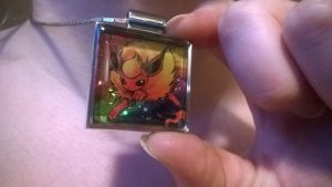 holographic Flareon pendant by HiddenStash