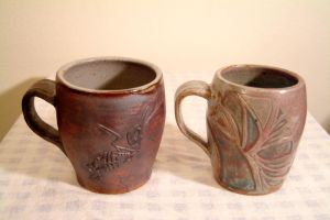 Carved mugs by Recycled-Oxygen