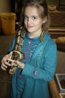 Montana with a Ball Python by icantthinkofaname-09