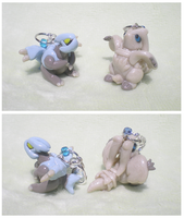 Kyurem and Reshiram charms by Foureyedalien