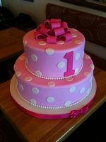 Large Two Tiered Pink Bow Cake by Spudnuts