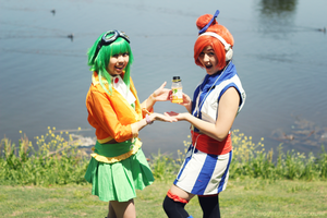 Orange Juice for Sale - GUMI and Akikoloid-chan by paintingnonsense