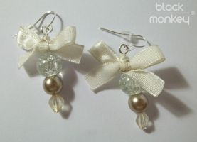 ribbon earrings by black--monkey