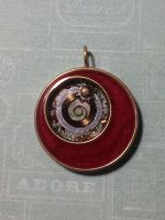 Red resin pendant by sillysarasue