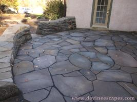 dry laid flagstone patio in Chester Springs by Devine-Escapes