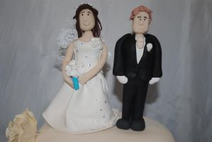 Bride and groom cake toppers by starry-design-studio