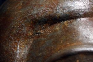 BUDDHA MASK in corroded iron finish - head detail by Faust-and-Company
