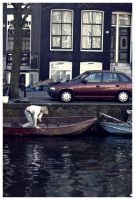 A man cleaning his boat by stillaut