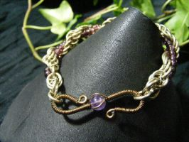 Spiral Bangle Bracelet With Purple Beads by BacktoEarthCreations